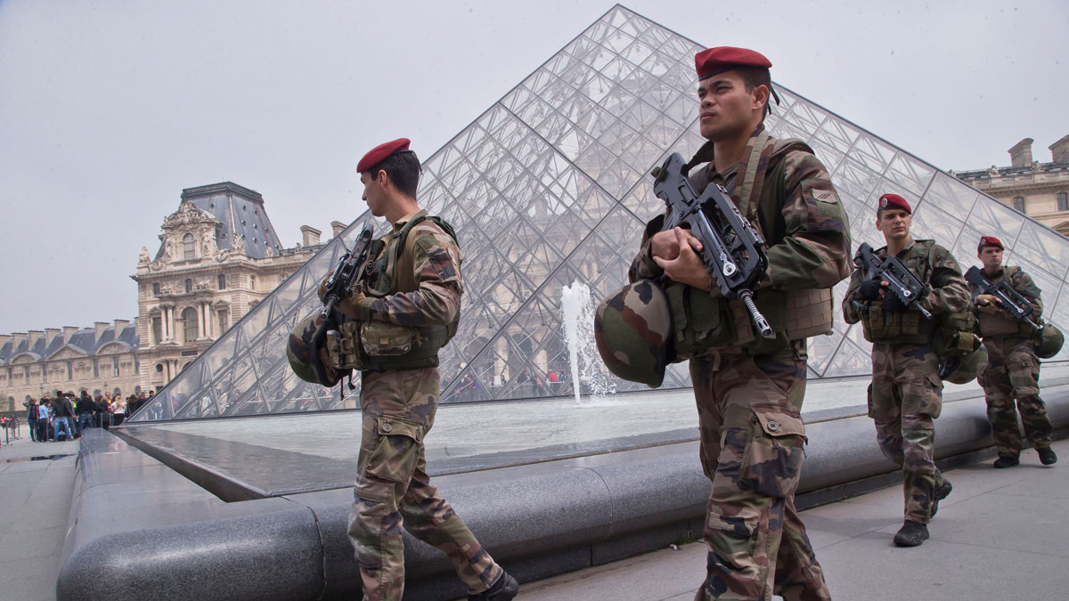 French soldiers patrol by the glass pyramid at the Louvre museum in Paris, Friday, May 13, 2016.