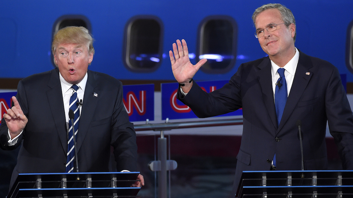 Republican presidential candidate Donald Trump, left, speaks as former Florida Gov. Jeb Bush reacts during the CNN Republican presidential debate at the Ronald Reagan Presidential Library and Museum, Wednesday, Sept. 16, 2015, in Simi Valley, Calif.