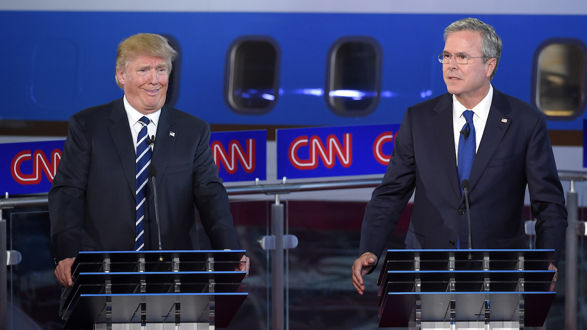 Republican presidential candidate Donald Trump, left, reacts as former Florida Gov. Jeb Bush speaks during the CNN Republican presidential debate at the Ronald Reagan Presidential Library and Museum, Wednesday, Sept. 16, 2015, in Simi Valley, Calif.