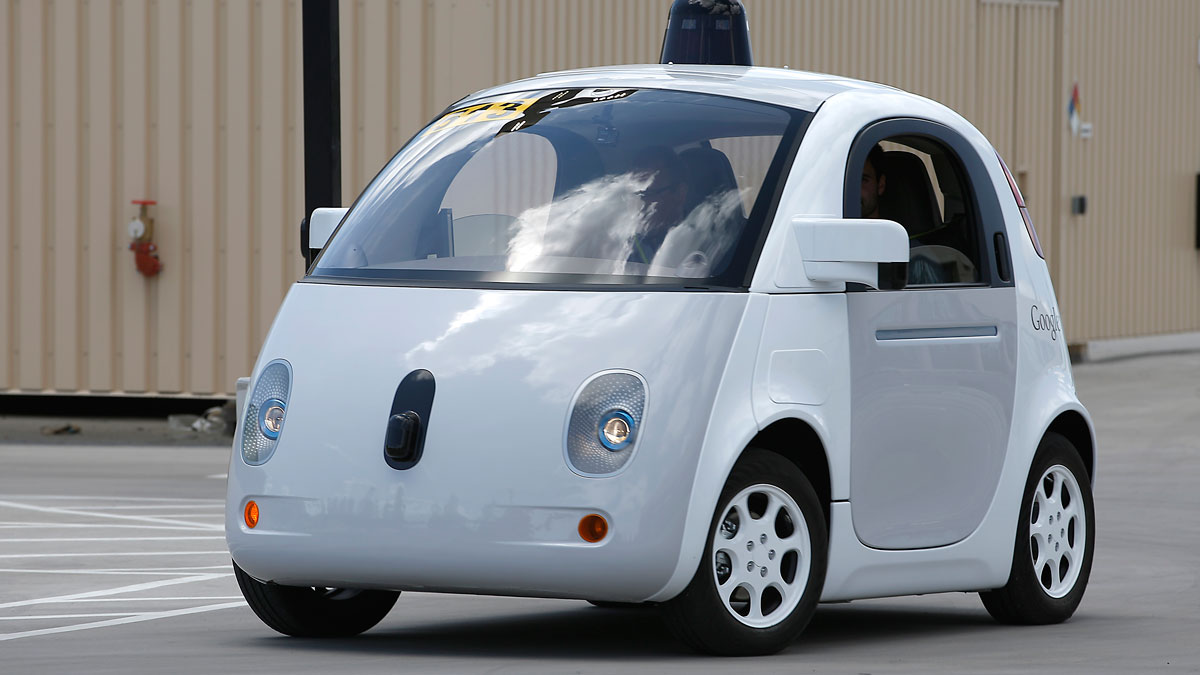 Google's new self-driving prototype car drives around a parking lot during a demonstration at Google campus on Wednesday, May 13, 2015, in Mountain View, Calif.