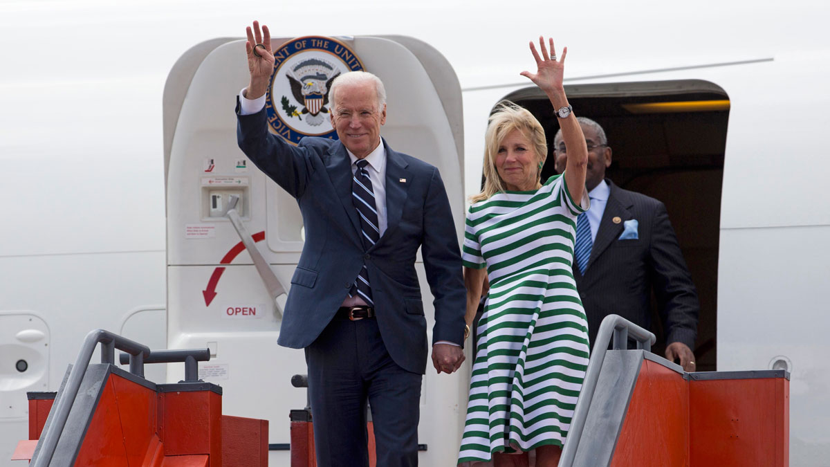 U.S. Vice President Joe Biden, left, and his wife Jill Biden wave as they arrive to an air force base in Guatemala City, Monday, March 2, 2015. Joe Biden is starting a two day trip to meet with the leaders of Guatemala, El Salvador and Honduras regarding immigration issues.