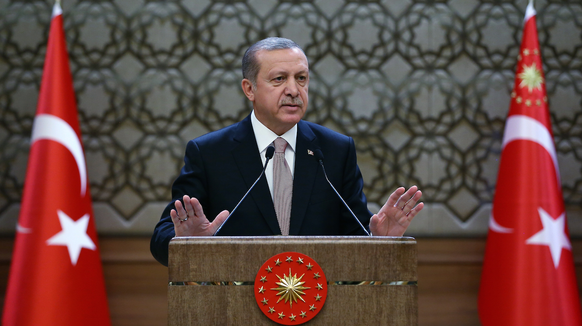 In this Nov. 26, 2015, photo, Turkish President Recep Tayyip Erdogan addresses a meeting of local administrators at his palace in Ankara, Turkey.