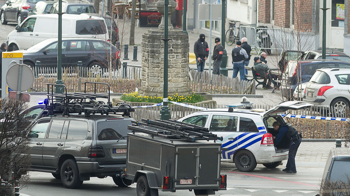Police cordon off an area in Brussels Tuesday March 15, 2016, after police launched an anti-terror raid linked to last year's Paris attacks in a Brussels neighborhood and three police officers were slightly injured when shots were fired, officials said. A police official, who requested anonymity because the operation was still ongoing, said the exact circumstances of the incident were still unclear, or whether the police officers were struck by bullets or injured in another way.