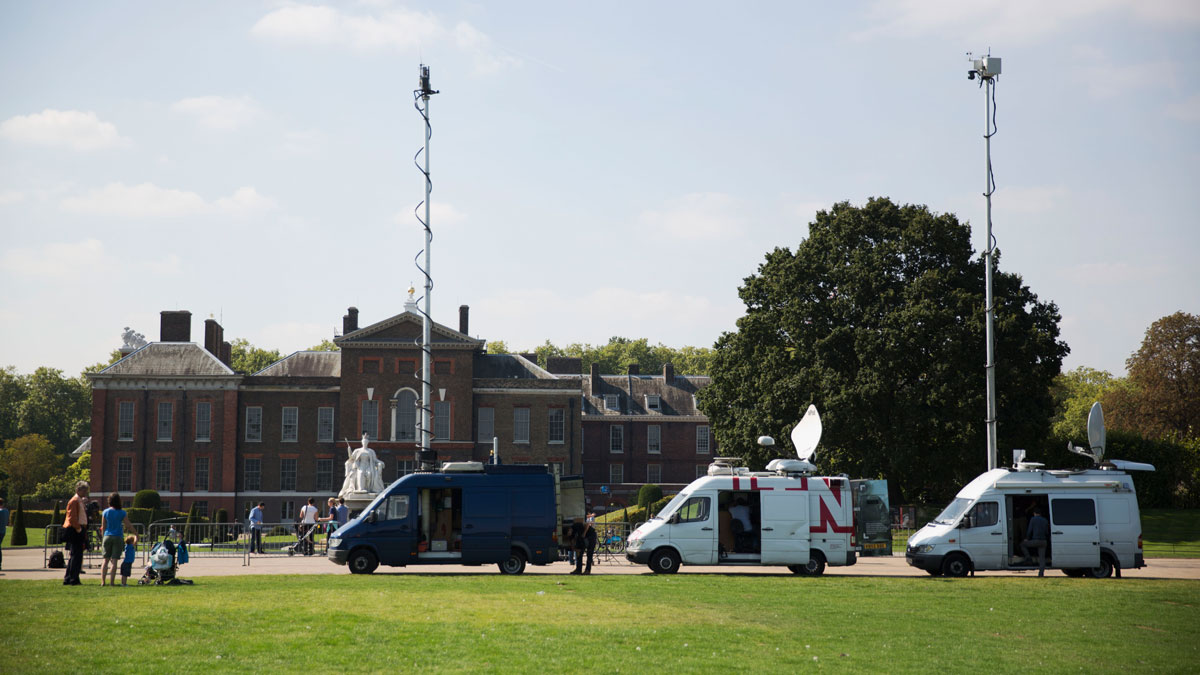File photo: Television news satellite trucks lineup to report on the second pregnancy of Britain's Kate Duchess of Cambridge and Prince William outside their residence Kensington Palace in London, Monday, Sept. 8, 2014.