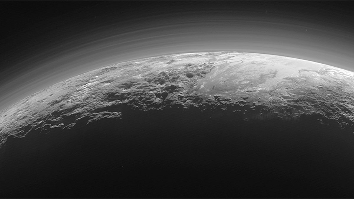 This July 14, 2015 photo released by NASA on Thursday, Sept. 17, 2015 shows the atmosphere and surface features of Pluto, lit from behind by the sun. It was made 15 minutes after the New Horizons' spacecraft's closest approach.