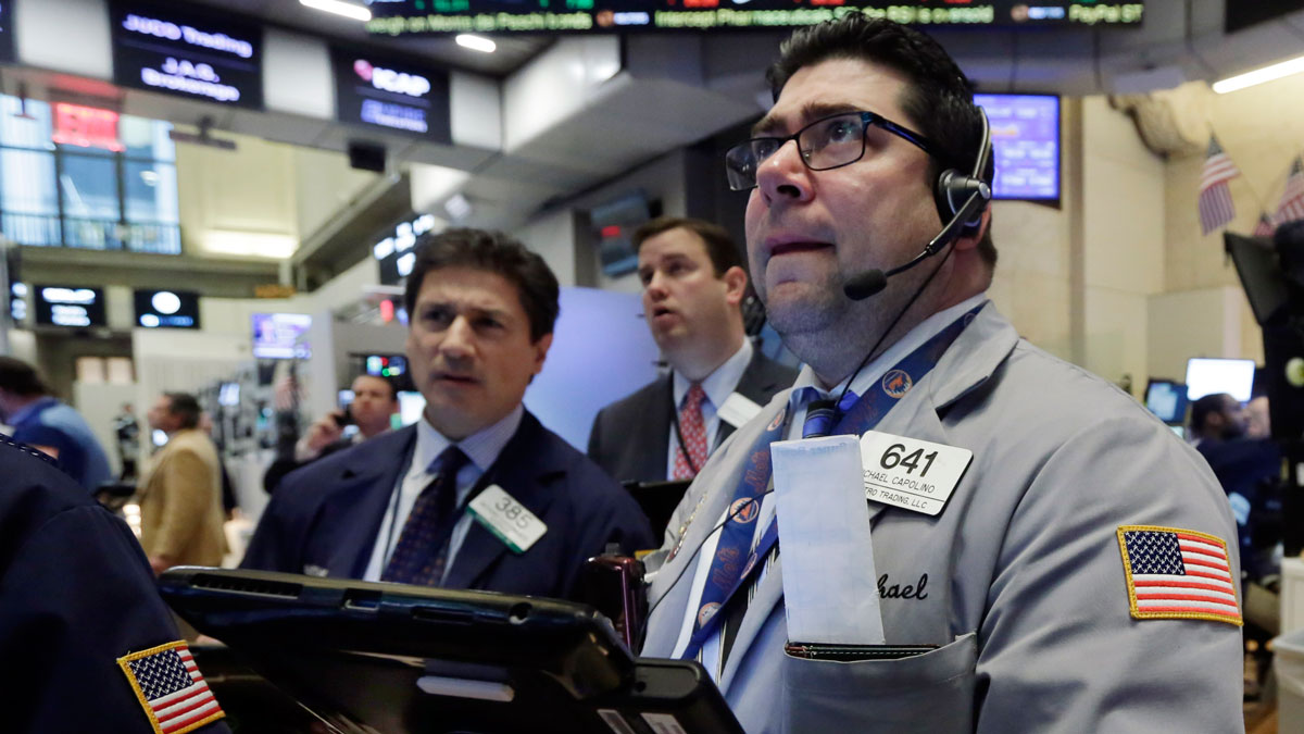 In this file photo, Michael Capolino, right, works with fellow traders on the floor of the New York Stock Exchange, Wednesday, Jan. 20, 2016. Energy stocks are leading an early rally on Wall Street Friday as the price of crude oil surges.