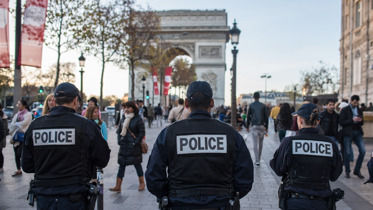 FILE- French police officers patrol on the Champs Elysees in Paris, Nov. 15, 2015.