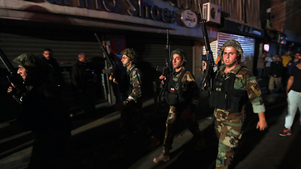 Lebanese soldiers deploy near the site of a twin suicide attack in Burj al-Barajneh, southern Beirut, Lebanon, Thursday, Nov. 12, 2015 that struck a Shiite suburb killed and wounded dozens, according to a Lebanese official.