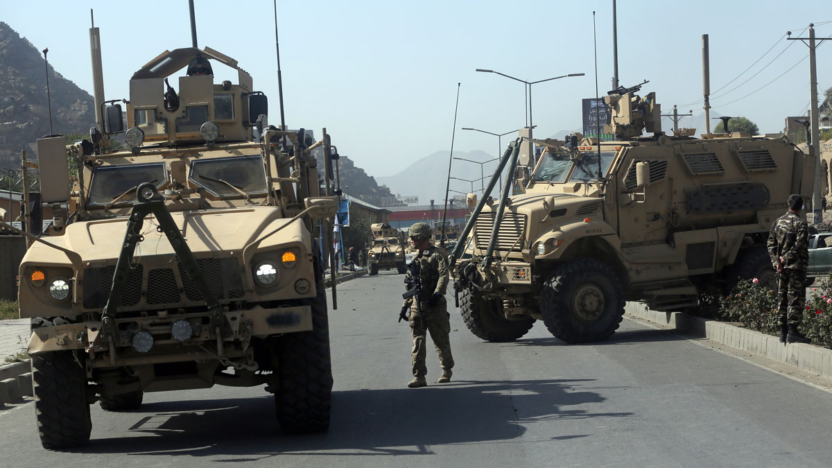 File Photo: A U.S. soldier directs his colleague at the site a bomb attack that targeted several armored vehicles belonging to forces attached to the NATO Resolute Support Mission, in downtown of Kabul, Afghanistan, Sunday, Oct. 11, 2015.