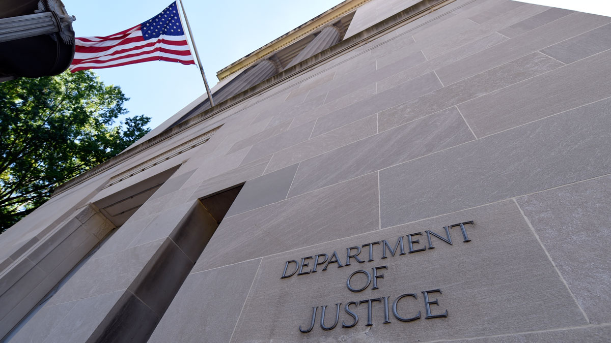 The view of the Justice Department in Washington, Thursday, Aug. 27, 2015. The Associated Press sued the U.S. Department of Justice Thursday over the FBI's failure to provide public records related to the creation of a fake news story used to plant surveillance software on a suspect's computer.