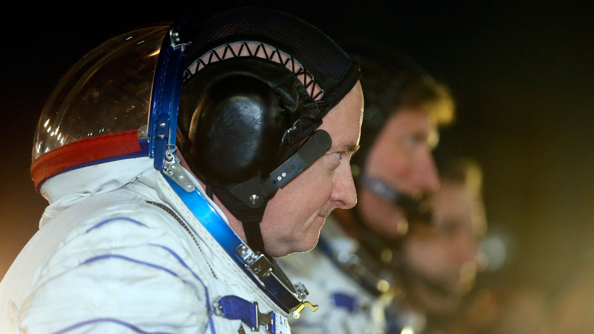 U.S. astronaut Scott Kelly, left, Russian cosmonauts Gennady Padalka, centre, and Mikhail Korniyenko, right, the crew members of the mission to the International Space Station, ISS, report to members of the State Committee prior the launch of Soyuz-FG rocket at the Russian leased Baikonur cosmodrome, Kazakhstan, Friday, March 27, 2015.