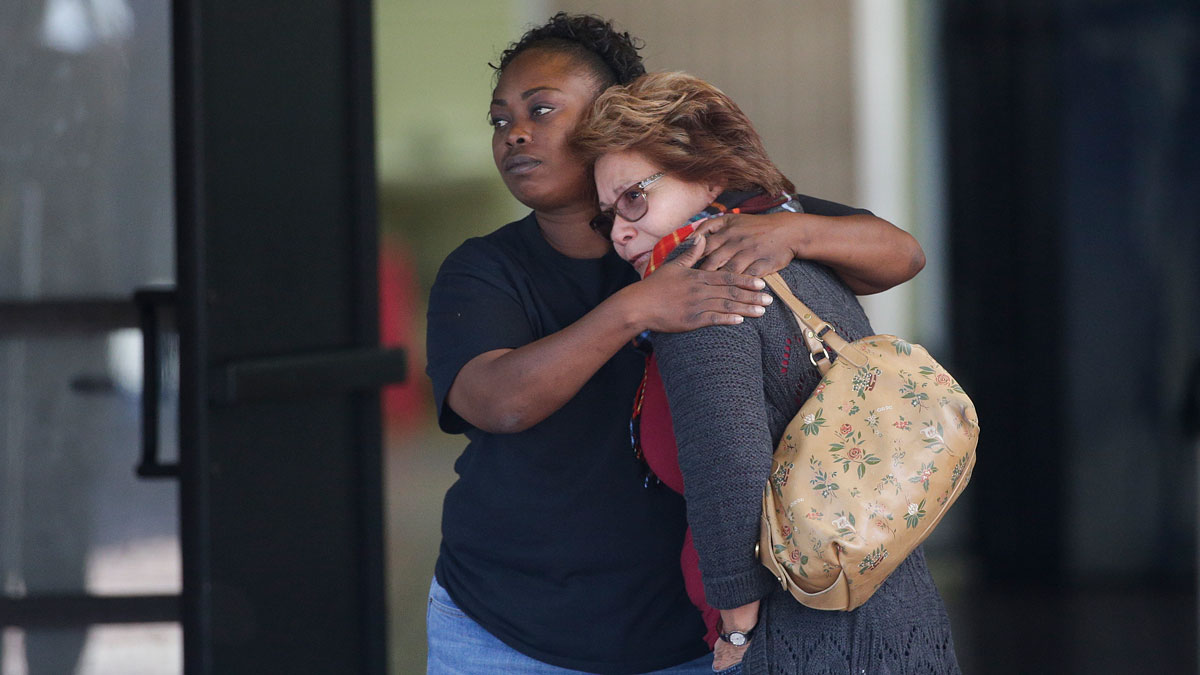 Two women embrace at a community center where family members are gathering to pick up survivors after a shooting rampage that killed multiple people and wounded others at a social services center in San Bernardino, Calif., Wednesday, Dec. 2, 2015.