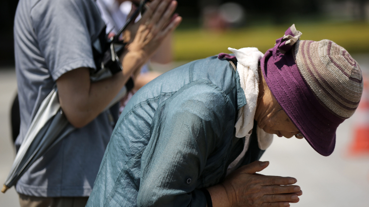 Visitors pray for the atomic bomb victims in Hiroshima, western Japan Wednesday, Aug. 5, 2015. Japan will mark the 70th anniversary on Aug. 6 of the atomic bombing on Hiroshima.