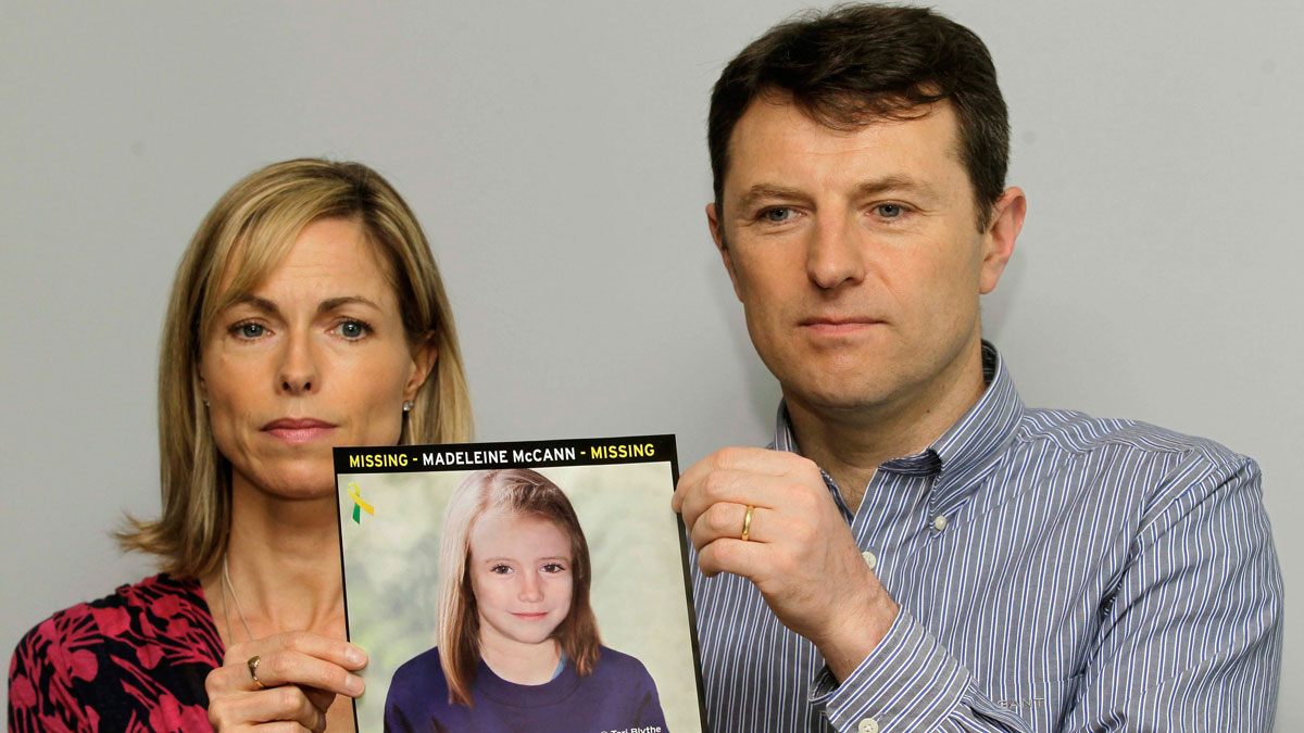 In this May 2, 2012 file photo, Kate and Gerry McCann pose for the media with a missing poster depicting an age progression computer generated image of their daughter Madeleine at nine years of age, to mark her birthday and the 5th anniversary of her disappearance during a family vacation in southern Portugal in May 2007, during a news conference in London. Portuguese prosecutors have ordered the reopening of the police investigation into the disappearance of British girl Madeleine McCann, after a review of evidence found new leads in the case, Portugal's public broadcaster and British police said Thursday Oct. 24, 2013.