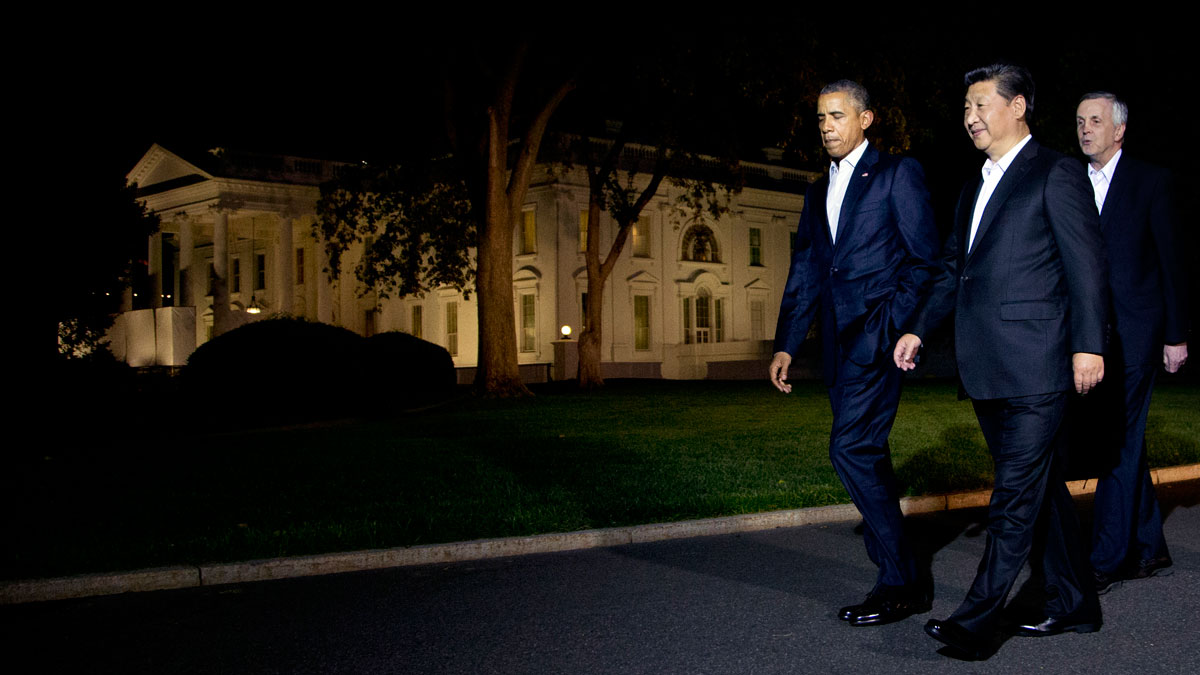President Barack Obama and Chinese President Xi Jinping, front right, walk on the North Lawn of the White House in Washington, Thursday, Sept. 24, 2015, for a private dinner at the Blair House, across the street from the White House. Xi arrived in Washington late Thursday for a State Visit. Obama has invested more time building personal ties with the Chinese president than with most other world leaders. Following the presidents is an American interpreter.