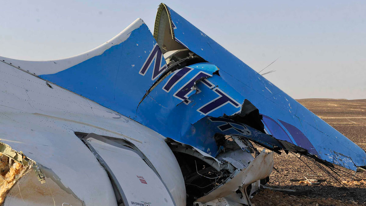 his photo released by the Prime Minister's office shows the tail of a Metrojet plane that crashed in Hassana, Egypt on Saturday, Oct. 31, 2015.