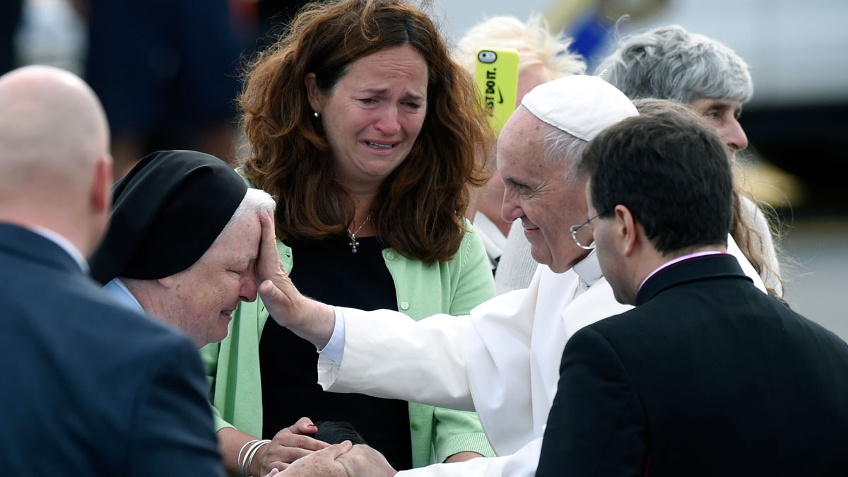 Pope Francis stops to meet people after arriving at Philadelphia International Airport in Philadelphia, Saturday, Sept. 26, 2015.