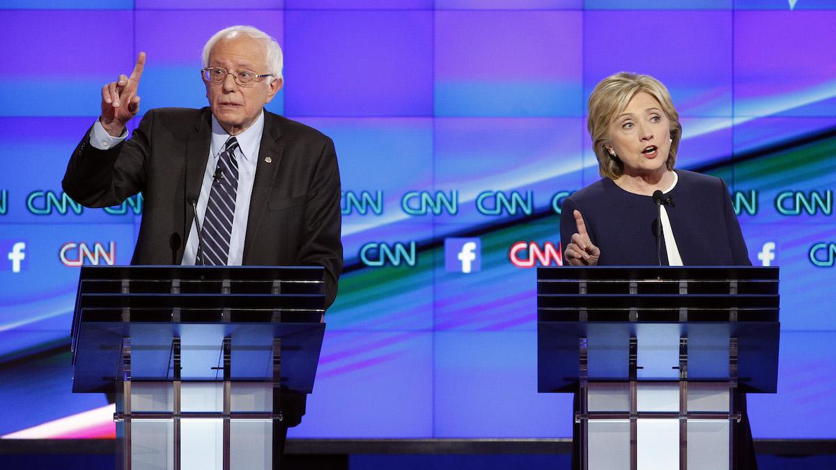 Hillary Rodham Clinton, right, and Sen. Bernie Sanders, of Vermont, speak during the CNN Democratic presidential debate Tuesday, Oct. 13, 2015, in Las Vegas.