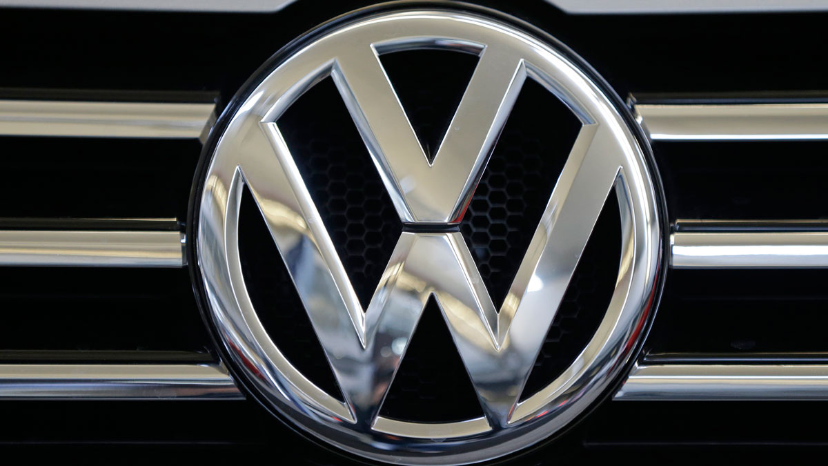 The Volkswagen logo on the grill of a car.