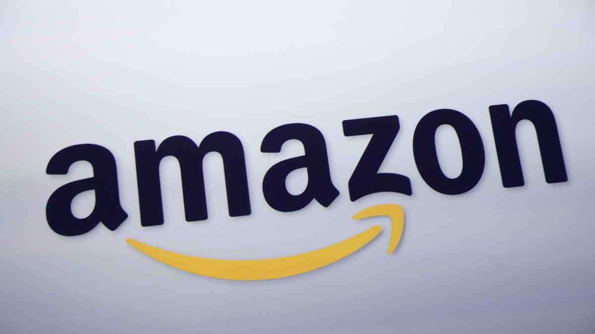 In this Sept. 28, 2011 file photo, the Amazon.com logo is displayed at a news conference in New York. The company announced on Nov. 2, 2015, that it will offer 20 weeks of paid maternity leave.