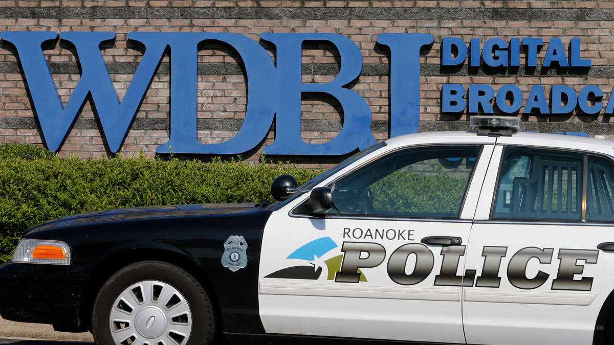 A police cruiser keeps vigil in front of the studios of WDBJ-TV7 in Roanoke, Va., Aug. 27, 2015.