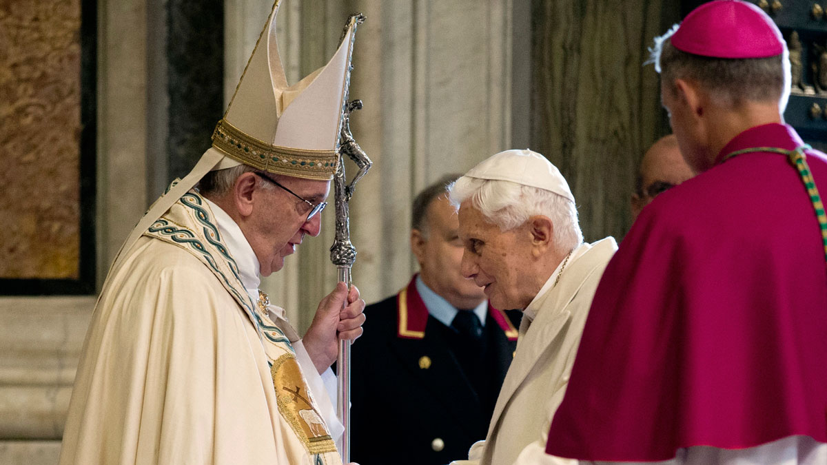 File image of Pope Francis, left, and Pope Emeritus Benedict XVI entering St. Peter's Basilica accompanied by Monsignor Georg Gaenswein, right, at the Vatican, Tuesday, Dec. 8, 2015.