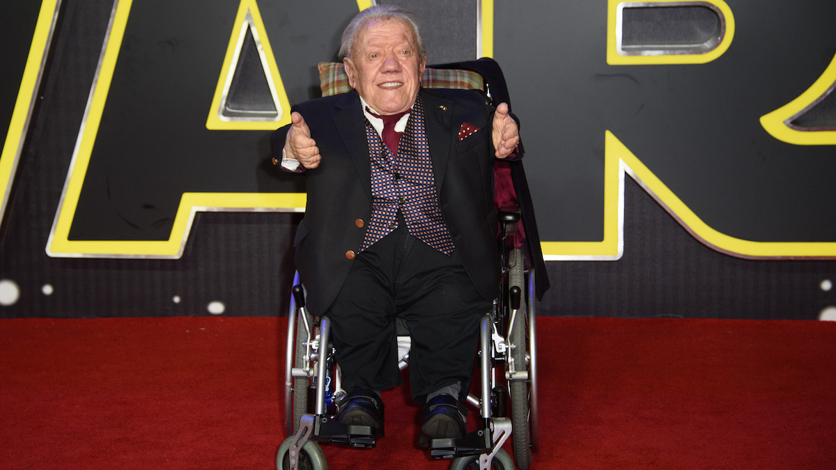 In this file photo, Kenny Baker poses for photographers upon arrival at the European premiere of the film 'Star Wars: The Force Awakens ' in London, Wednesday, Dec. 16, 2015. His niece, Abigail Shield, said he was found dead by a nephew on Saturday at his home in northwest England after a long illness.
