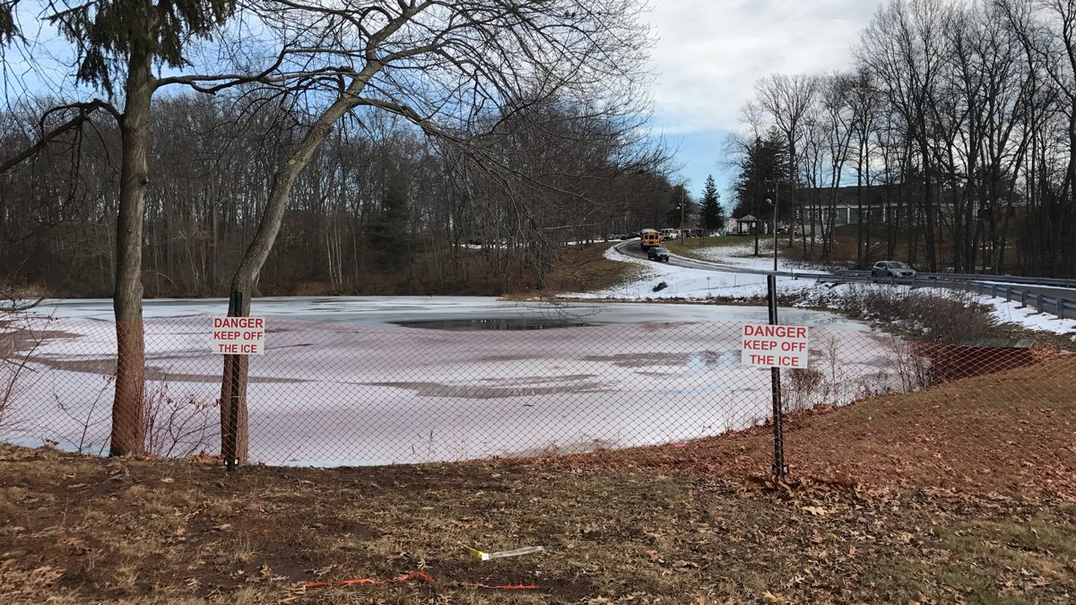 A student at Adlebrook in Cromwell fell through the ice while standing in the middle of a pond near the school Wednesday morning.
