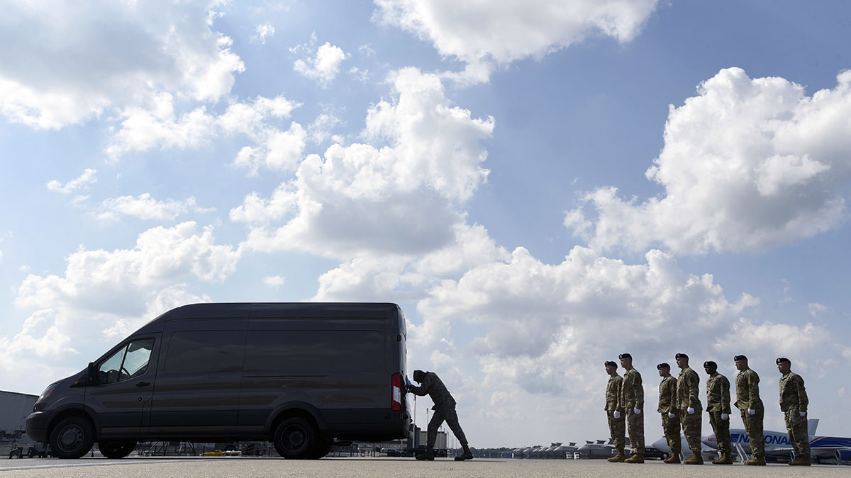 Airman First Class Henry Abreu Maria, center, closes a vehicle holding transfer cases containing the remains of Sgt. Jonathon Michael Hunter and Spc. Christopher Michael Harris at Dover Air Force Base, Del., Aug. 4, 2017. According to the Department of Defense, Hunter, 23, of Columbus, Ind., and Harris, 25, of Jackson Springs, N.C., died Aug. 2, 2017, in Kandahar, Afghanistan, of injuries sustained from an improvised explosive device.