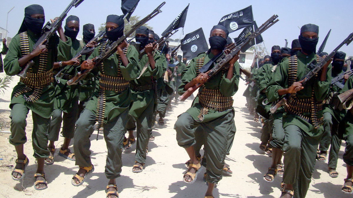 In this Thursday, Feb. 17, 2011 file photo, al-Shabab fighters march with their weapons during military exercises on the outskirts of Mogadishu, Somalia. U.S. military officials say they conducted an airstrike, killing five al Shabab militants during a raid on May 12, 2016.