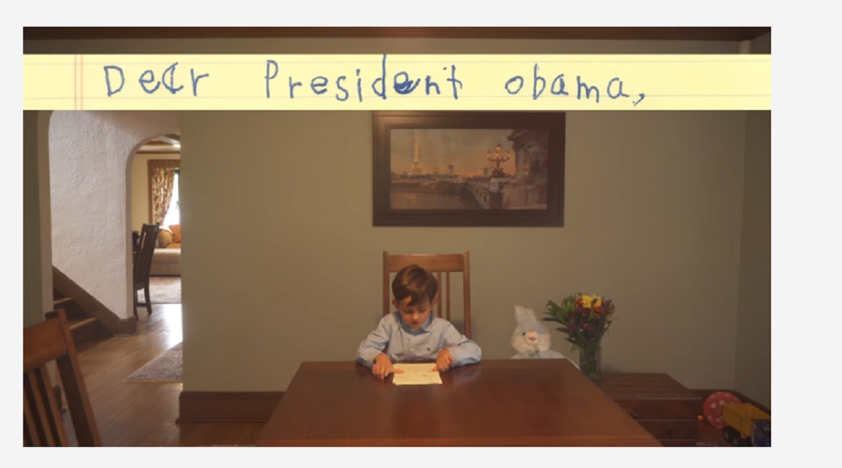 Alex, a six-year-old boy from Scarsdale, New York, is seen reading a letter he wrote to President Obama about a Syrian refugee.