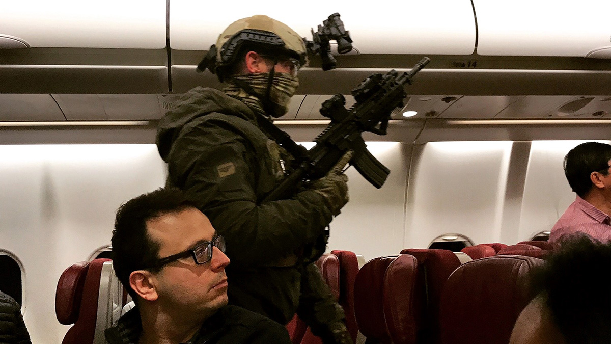An armed tactical officer sweeps a Malaysia Airlines flight at Melbourne Airport in Australia on May 31, 2017.