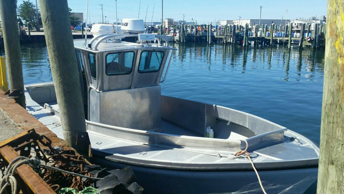 The US Coast Guard is searching for 54-year-old Linda Carman and her 22-year-old son Nathan, who were last seen leaving from Point Judith, Rhode Island in this 32-foot aluminum boat.