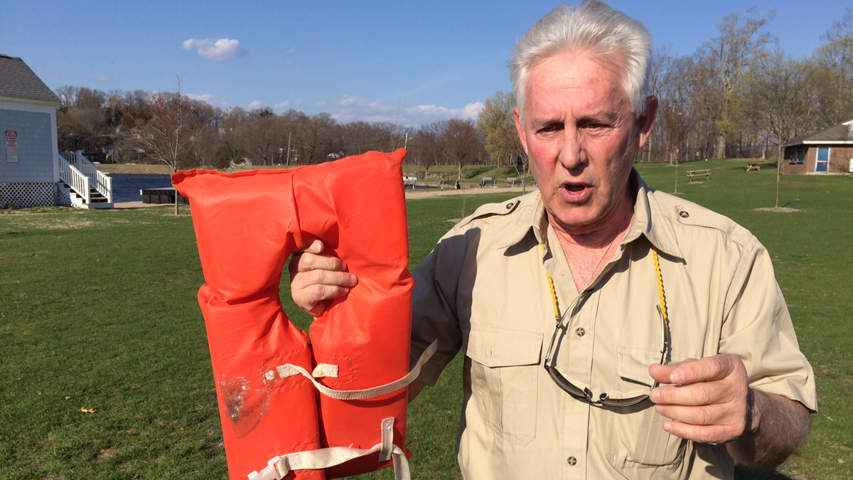 Boating instructor Chris Kuebler shows one type of lifejacket.