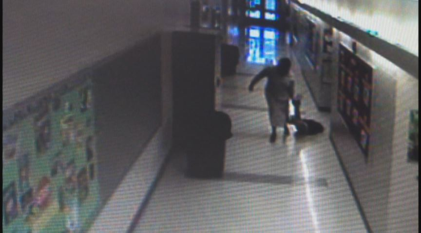 Video shows former a Bridgeport school principal dragging young students down the hallway.