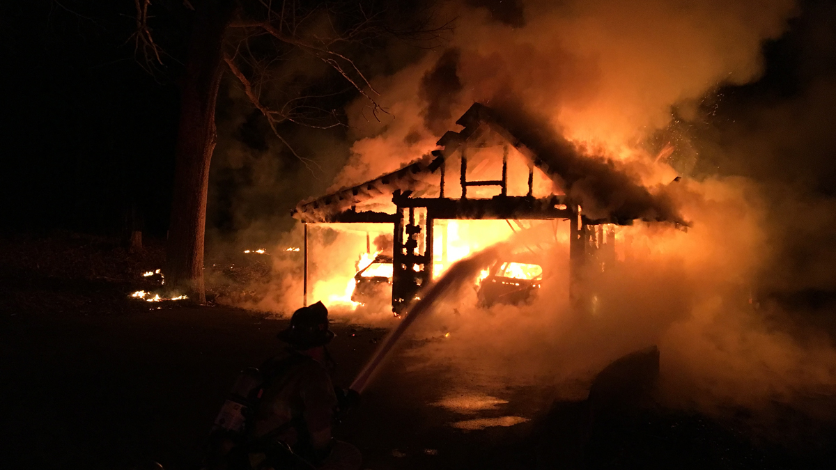 Fire ripped through a garage at a home on Blackberry Hill Road in Beacon Falls early Sunday morning.