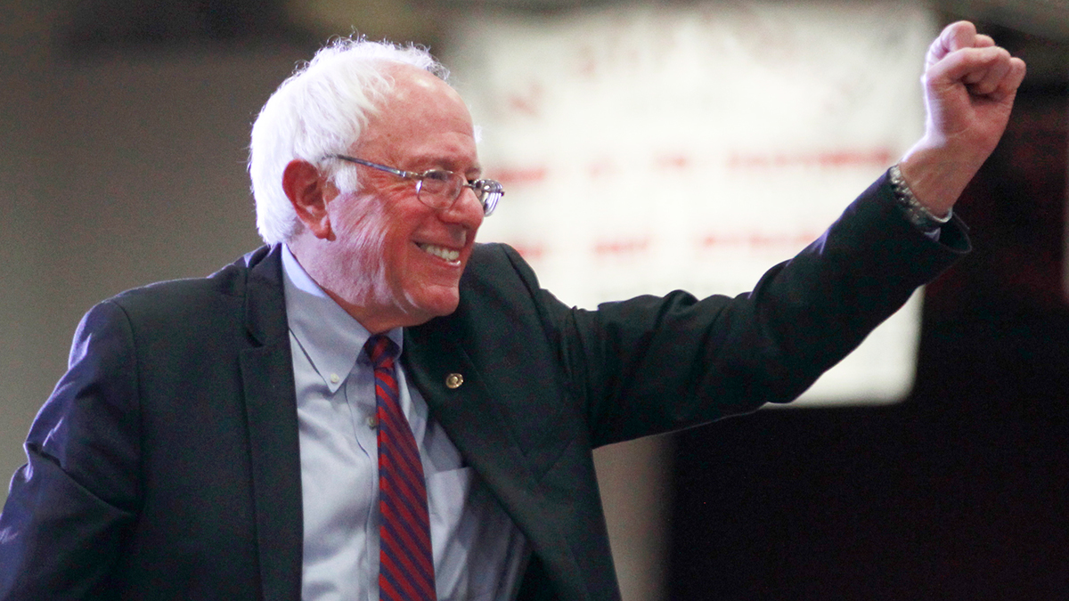 Democratic presidential candidate Bernie Sanders gives a fist pump after his speech at West High School at a campaign rally on March 21, 2016 in Salt Lake City, Utah.