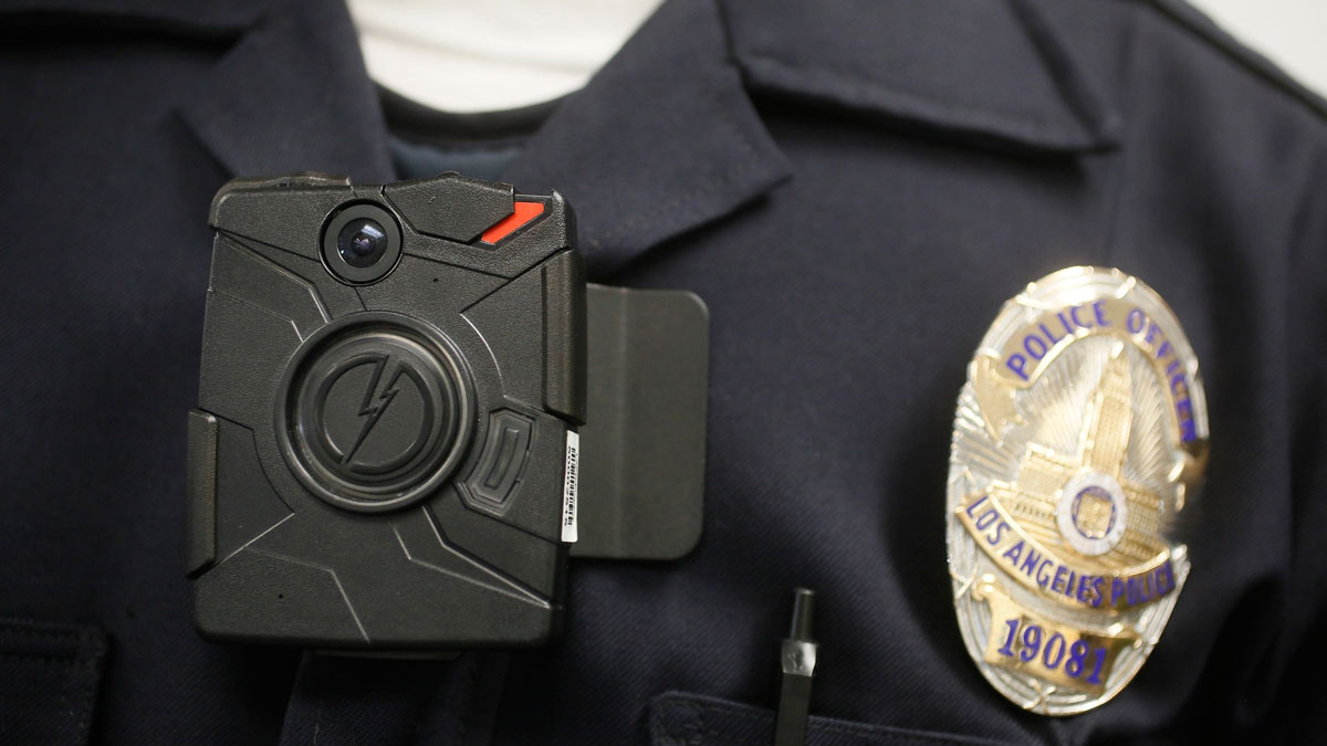 In this Jan. 15, 2014, file photo a Los Angeles Police officer wears an on-body camera during a demonstration in Los Angeles. A new scorecard has given police departments mixed reviews on their policies involving body cameras.