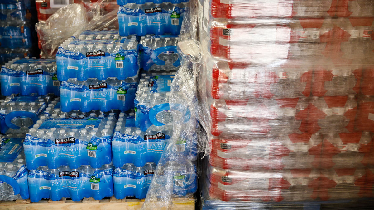 Cases of bottled water are shown at a fire station on February 7, 2016 in Flint, Michigan. Students in Portland, Oregon, will be given bottled water after officials discovered high levels of lead in the water in two of the city's schools.