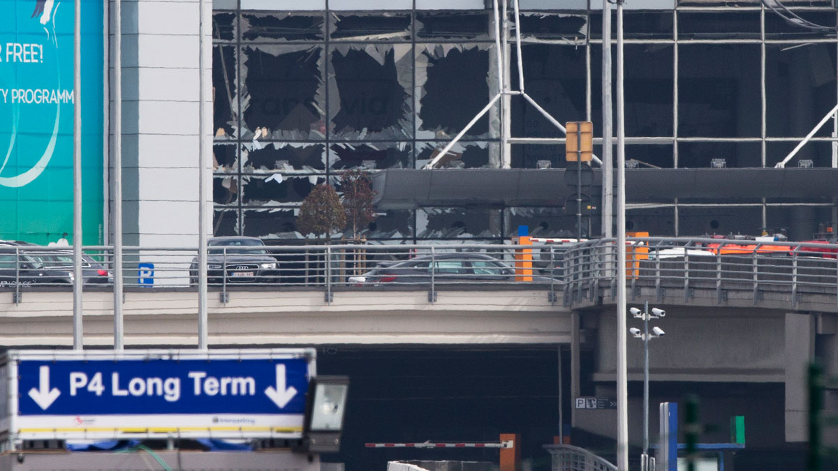 The blown out windows of Zaventem airport are seen after a deadly attack in Brussels, Belgium on Tuesday, March 22, 2016. Authorities in Europe have tightened security at airports, on subways, at the borders and on city streets after deadly attacks Tuesday on the Brussels airport and its subway system.