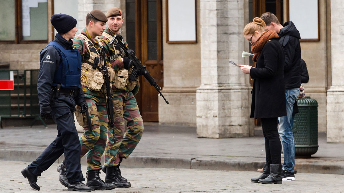 Belgian Army soldiers and a police officer patrol in the Grand Place in the center of Brussels on Friday, Nov. 20, 2015.  Salah Abdeslam, a French national who lived in Molenbeek, Belgium, is currently the subject of an international manhunt after the Paris attacks. Security has been stepped up in parts of Belgium as a precaution.