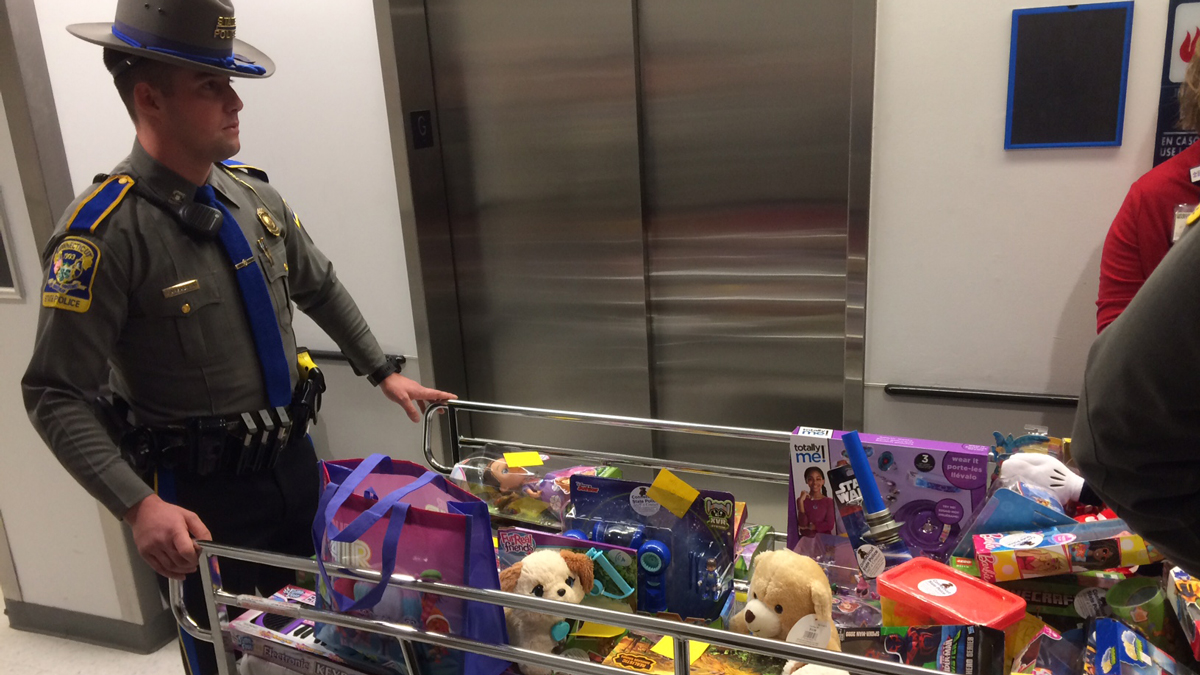 Troopers delivering toys to Connecticut Children's Medical Center patients Tuesday.