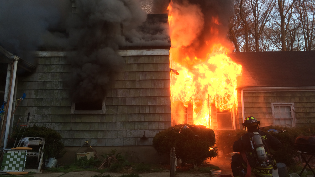 Flames coming from a home at 189 Cross Highway in Westport, Conn. Monday morning.