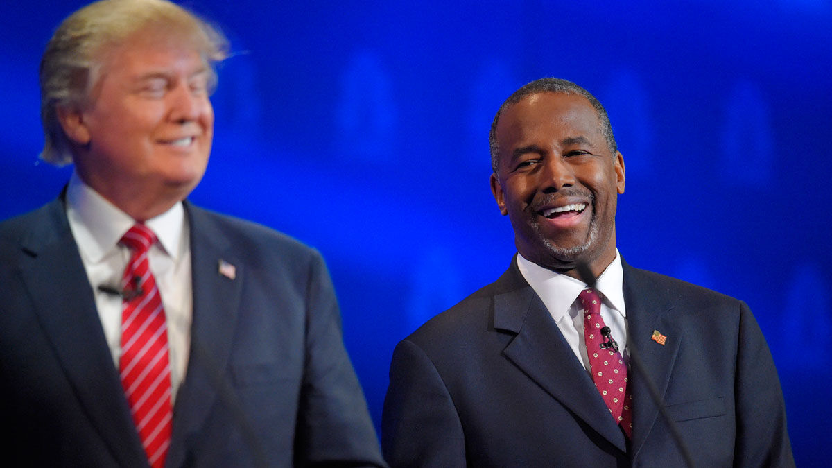 Ben Carson, right, and Donald Trump laugh together during the CNBC Republican presidential debate at the University of Colorado, Wednesday, Oct. 28, 2015, in Boulder, Colo.