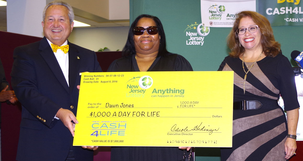 Sept. 22, 2016: Dawn Jones (center) buys lottery tickets every Monday. Last month the Trenton nurse hit the jackpot with CASH4LIFE, winning $1,000 a day for the rest of her life.