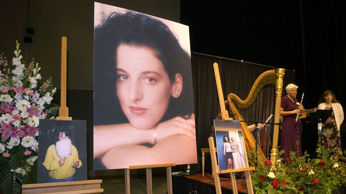 In this May 28, 2002 file photo, photographs of Chandra Levy are on display as musicians stand by at the memorial service for Levy at the Modesto Centre Plaza in Modesto, California.