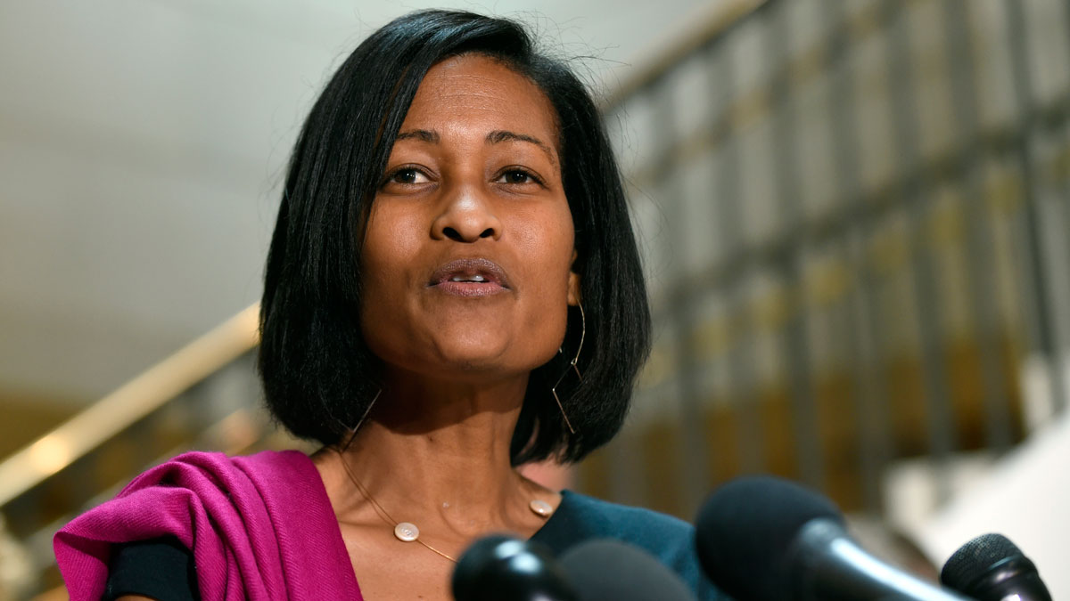 In this Sept. 3, 2015 file photo, former Hillary Rodham Clinton aide Cheryl Mills speaks to reporters on Capitol Hill in Washington. A federal judge granted a motion that would block the release of video of Mills' deposition about Clinton's personal email server.