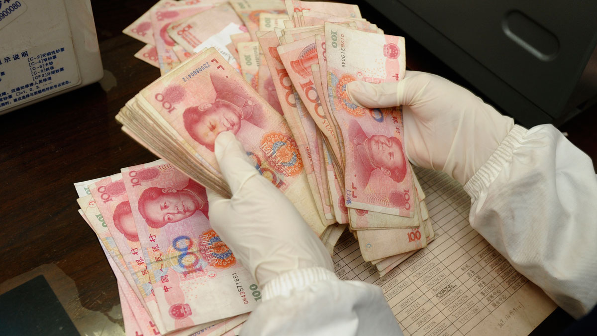 File image of employees counting money at a bank in China.