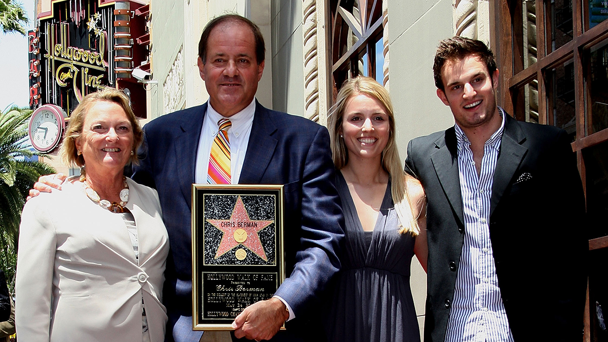 Sports anchor Chris Berman (C) and his family posed for photographers during installation ceremony honoring him with a star on the Hollywood Walk of Fame on May 24, 2010 in Hollywood, California.
