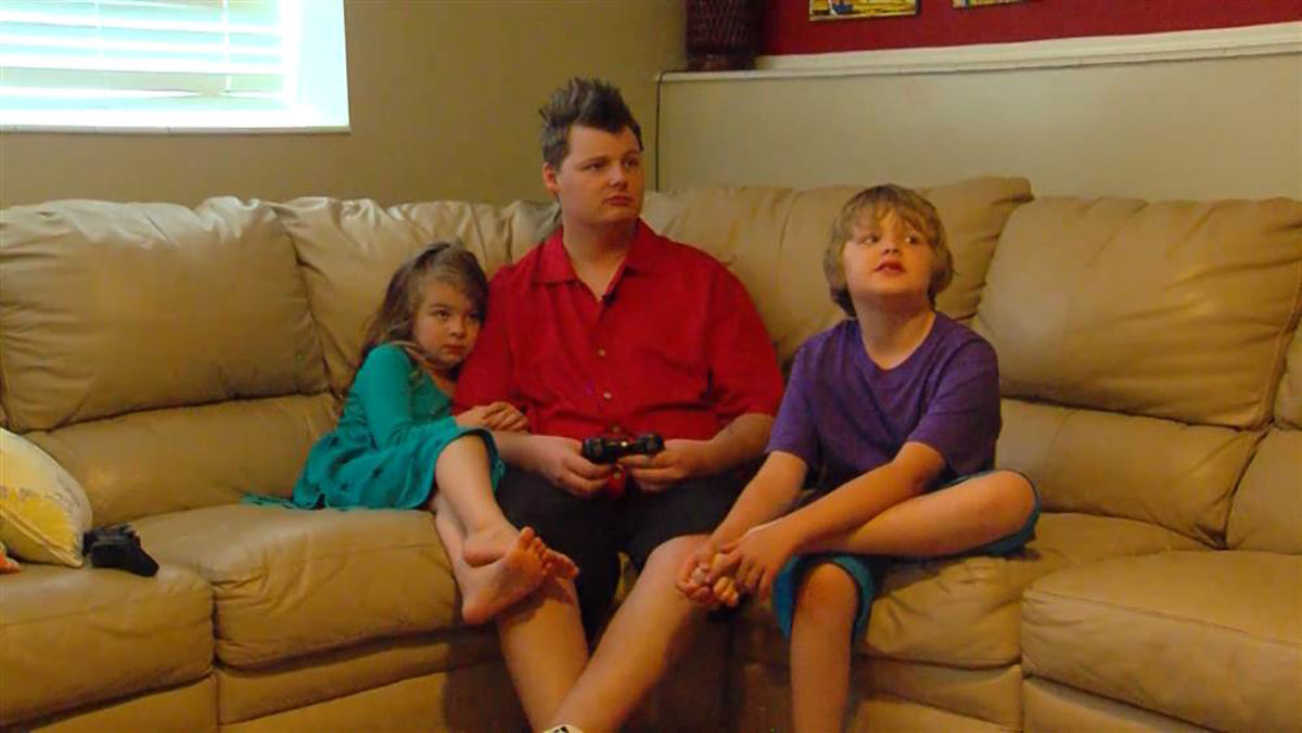 Christopher Adams with his 5-year-old daughter, Emery, and 7-year-old son, Kyler.